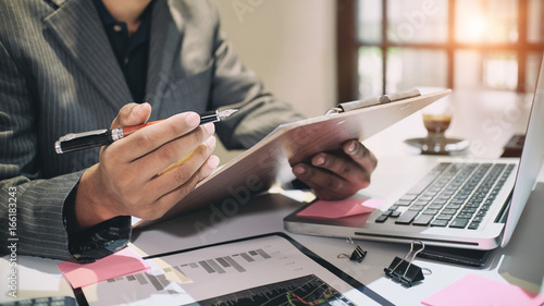 Cuadros en Lienzo Audit concept,Bookkeeper or financial inspector and secretary making report Financial Planning Report in Spreadsheet