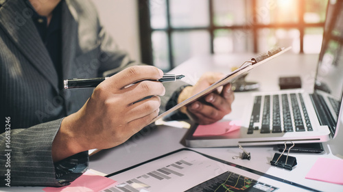 Fotografía  Audit concept,Bookkeeper or financial inspector and secretary making report Financial Planning Report in Spreadsheet