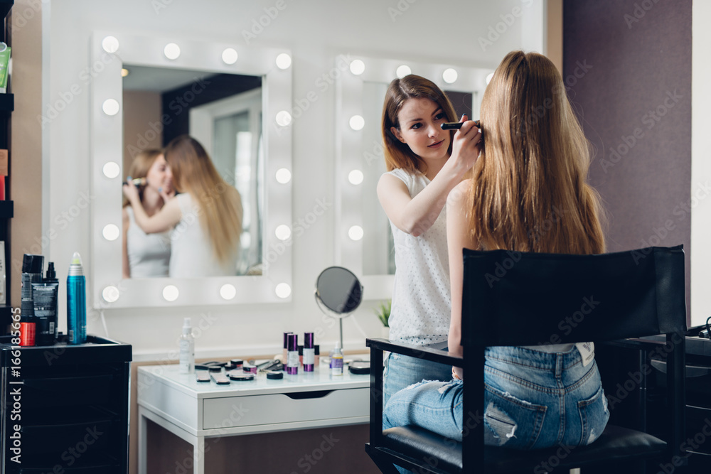 Fototapety, obrazy: Professional makeup artist working on young girl creating natural look in beauty salon