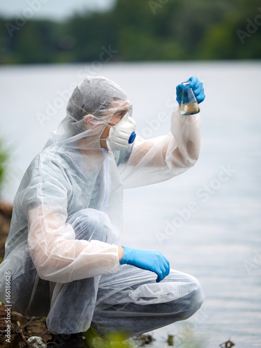 Valokuva  Chemist takes sample of water