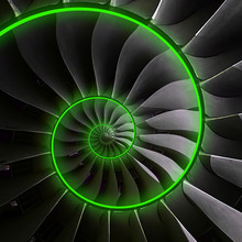 Turbine Blades Wings Spiral Green Neon Glow Effect Abstract Fractal Pattern Background. Spiral Industrial Production Metallic Turbine Background. Turbine Technology Abstract Fractal Pattern