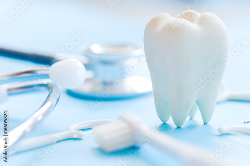 Valokuva  Dental model and dental equipment on blue background, concept image of dental background