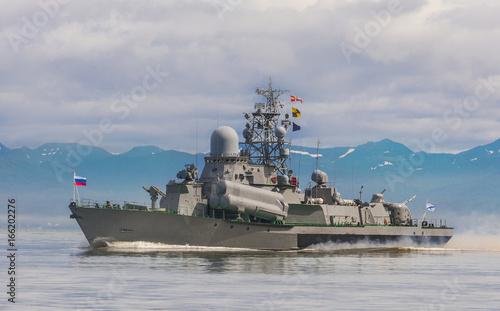 Russian warship going along the coast Wallpaper Mural