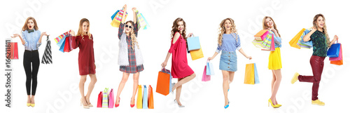 Fotografía  Beautiful women with shopping bags on white background