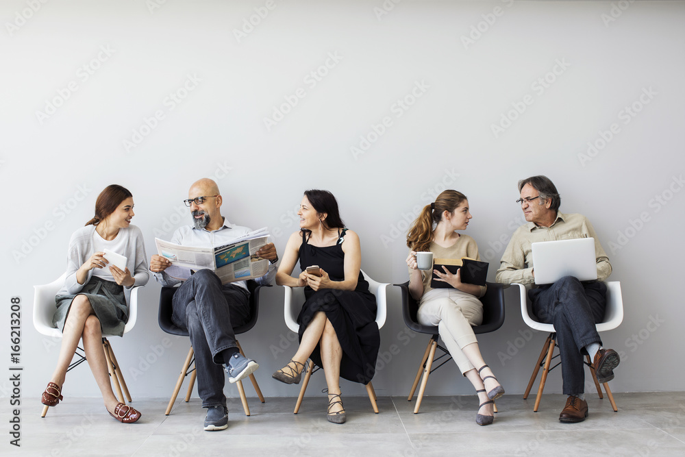 Fototapeta Group of people sitting on chairs