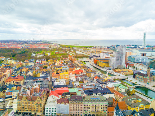 Aerial Malmo city view from above with harbour, turning Torso and the bridge on the horizon