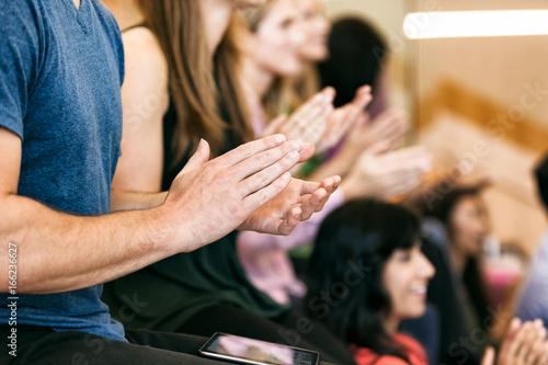 Photo Workspace: Focus On Hands As Audience Applauds