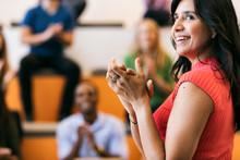 Workspace: Focus On Hands As Crowd Applauds