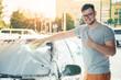 man woshing his car with sponge