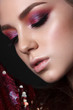 young model with red and lilac smoky eyes