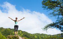 It's A Beautiful Life! Happy Woman In A Beautiful Mountain Nature Setting With Her Arms Up In The Air.