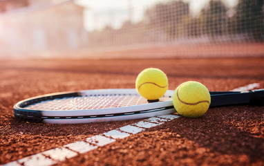 Fototapeta Tennis ball with racket on the tennis court. Sport, recreation concept
