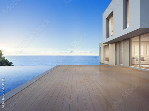 Fotografia Luxury beach house with sea view swimming pool and empty terrace in modern desig