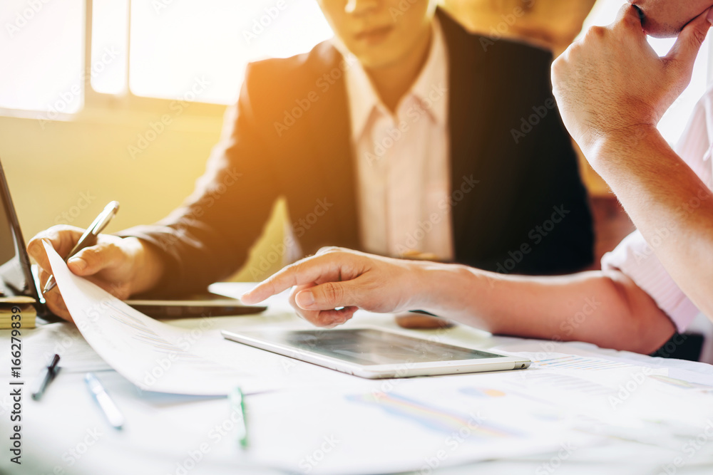 Fototapety, obrazy: Two businessman investment consultant analyzing company financial report balance sheet statement working with documents graphs. Concept picture for stock market, office, tax,and project.