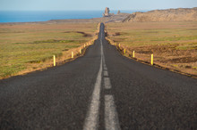 A Straight Tarmac Road Leads T...