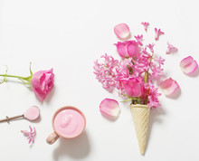Flowers In A Waffle Cone With Yogurt On White Background