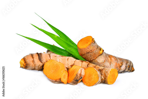 Poster Condiments turmeric root with green leaves isolated on white background