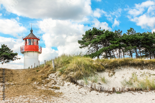 Foto op Aluminium Vuurtoren Old lighthouse Gellen on sunny summer day. Hiddensee, Baltic Sea.