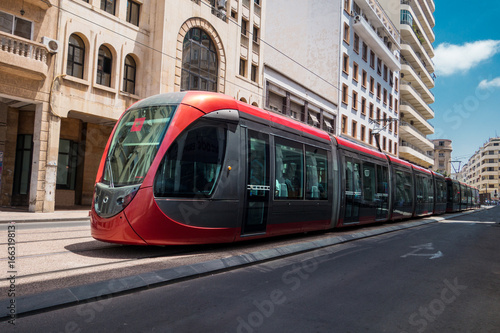Wall Murals Photo of the day a tram passing on railways between old buildings - Casablanca - Morocco