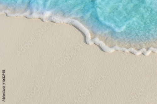 Photo sur Toile Plage Soft waves of blue sea on the Maldives beach for the background.