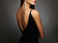 Woman In A Black Sexy Dress And Jewelry