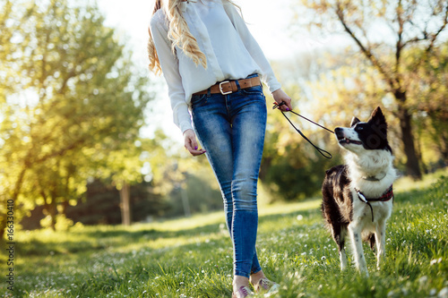 Fotografie, Obraz  Beautiful woman and dog enjoying their time in nature