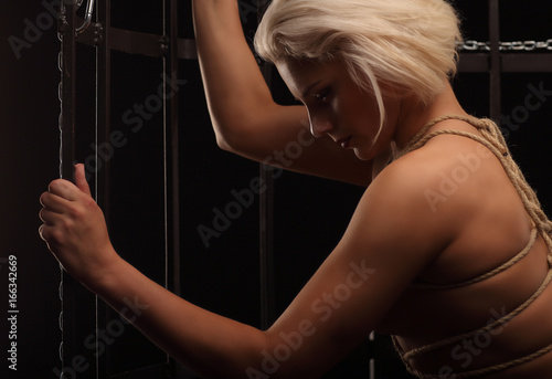 Naked woman in cage