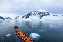 Beautiful Colourful Kayaks On The Blue Ocean, Antarctic Peninsula, Antarctica