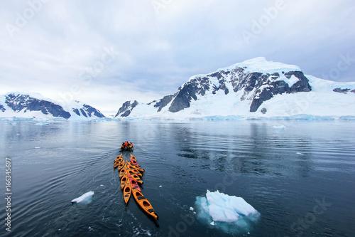 Foto auf Gartenposter Antarktika Beautiful colourful kayaks on the blue ocean, Antarctic Peninsula, Antarctica