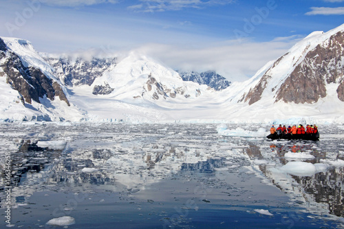 Tuinposter Antarctica Inflatable boat full of tourists, watching for whales and seals, Antarctic Peninsula, Antarctica