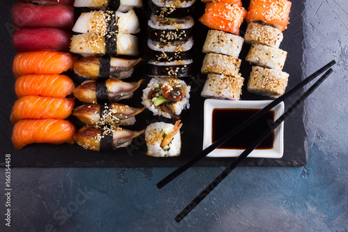 Fototapeta  Japanese sushi big set with two wooden black chopsticks, top view