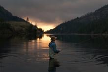 Fishing By A Lake At Sunset