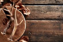 Deer Antlers With Leaves On Wooden Board
