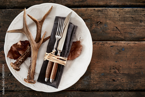 Poster Chasse Deer antlers with cutlery on plate