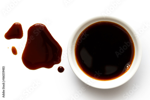 Soya sauce in white ceramic bowl isolated on white from above Wallpaper Mural