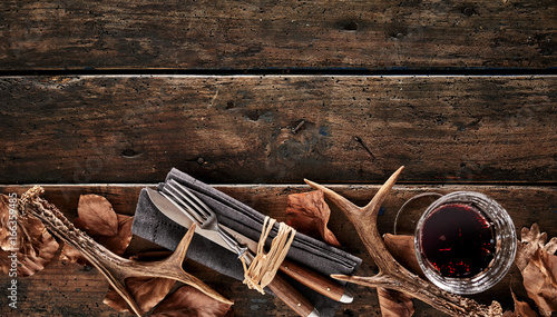 Foto op Canvas Hert Antlers, whiskey and cutlery rustic seasonal theme