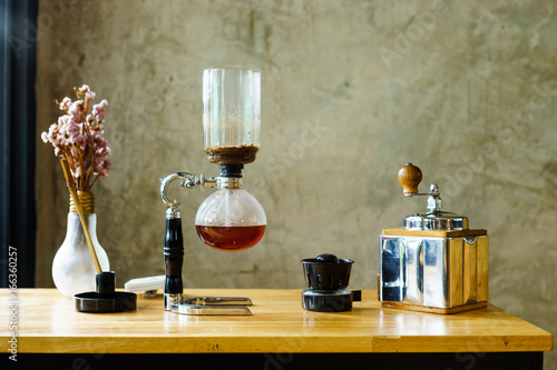 Photo siphon vacuum coffee maker at shop
