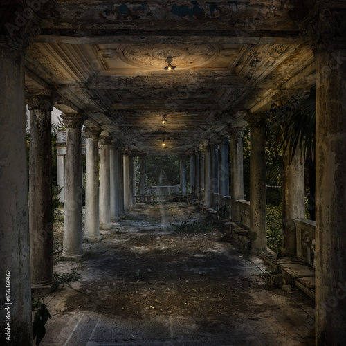 Old dilapidated corridor with columns  Twilight  In the
