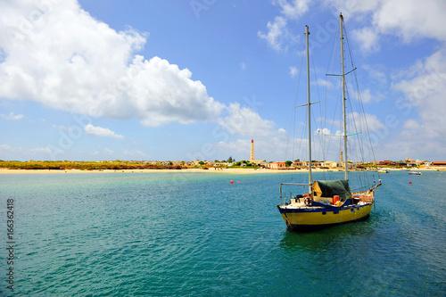 Fotografie, Obraz  Ilha da Culatra com o farol de Santa Maria, praias do Algarve, Portugal