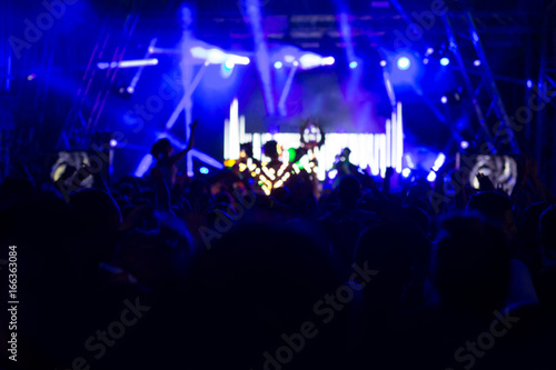 Blur Background Of Concert Crowd In Front Bright Stage Lights Musics