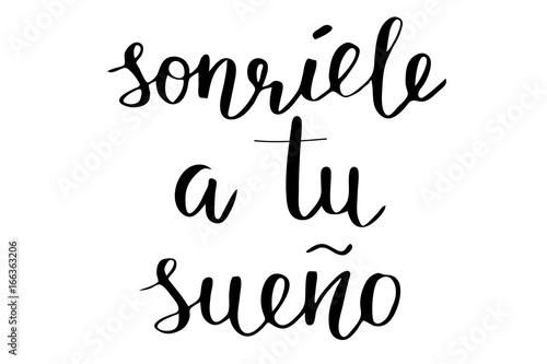 Fotografie, Obraz  Phrase in Spanish Smile to your dream