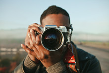 Man Taking Photos With A Vintage Camera