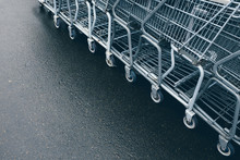 Row Of Metal Grocery Carts Outside Store