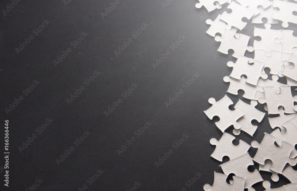 Fototapeta Puzzle pieces on a black slate with Text Space