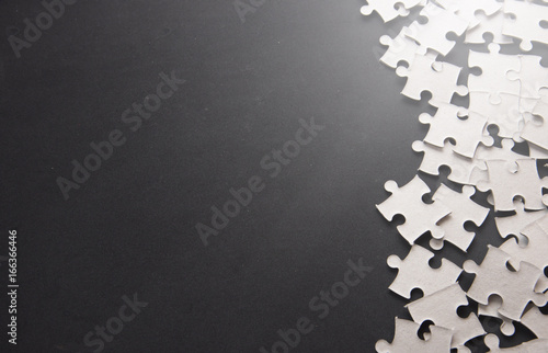 Obraz Puzzle pieces on a black slate with Text Space - fototapety do salonu