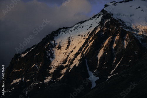 Mountain Snowfield bathed in Alpenglow Poster