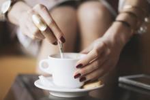 Woman Stirring Espresso