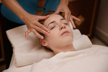 Fototapeta na wymiar Young woman having massage in spa salon, closeup view