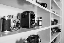 Collection Of Film Cameras On Shelf