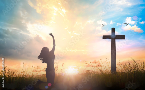 Obraz na płótnie Happy thanksgiving day concept: Silhouette of beautiful woman kneeling and raise